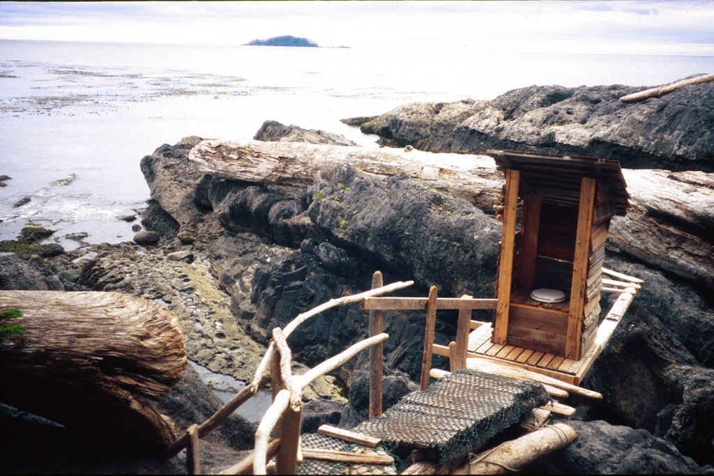 An outhouse with a view, which flushes twice a day. Queen Charlotte Islands in British Columbia Canada.